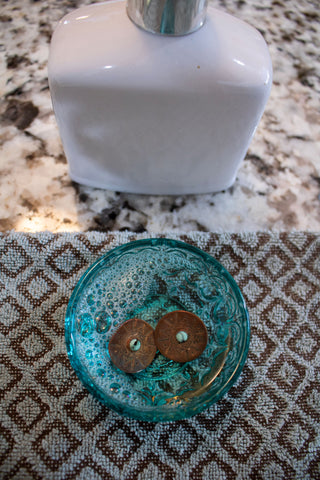 Warm water and soap tp clean your jewelry