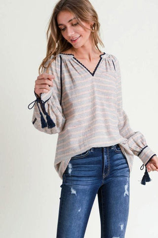 NAVY STRIPED V- NECK BLOUSE W/TASSEL CUFFS