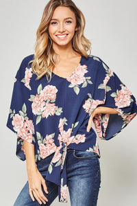 NEVER GETTING OLDER FLORAL TOP