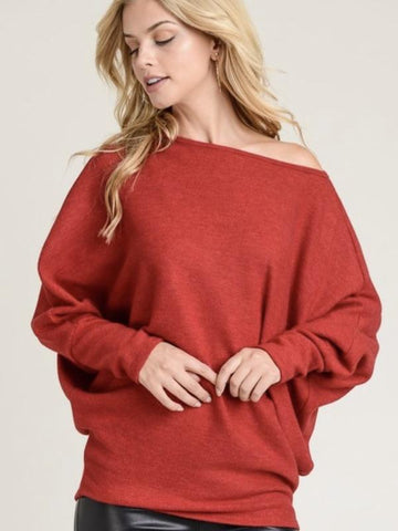 Red Knit Sweater With A Boat Neckline And Long Dolman Sleeves