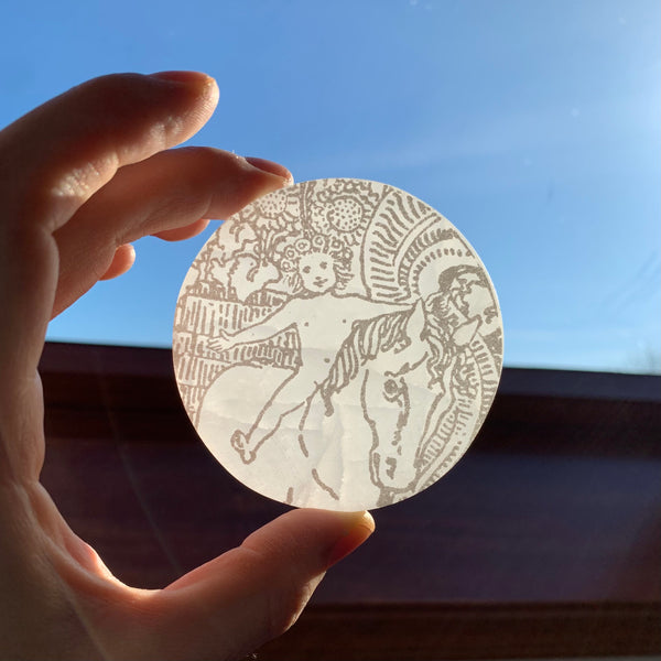 Engraved Selenite Circular Charging plate - Child from The Sun