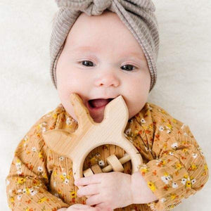 organic wooden baby rattle unicorn.