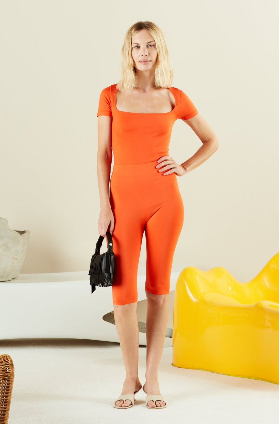 STRETCH Eero Bodysuit in Coral