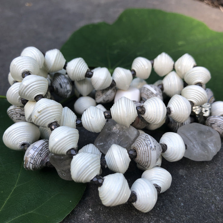 Make a statement with our one of a kind, Haitian Papillion Blanc beaded necklace. Hand strung with handmade beads individually rolled from a variety of recycled, printed paper and semi-precious gemstones.