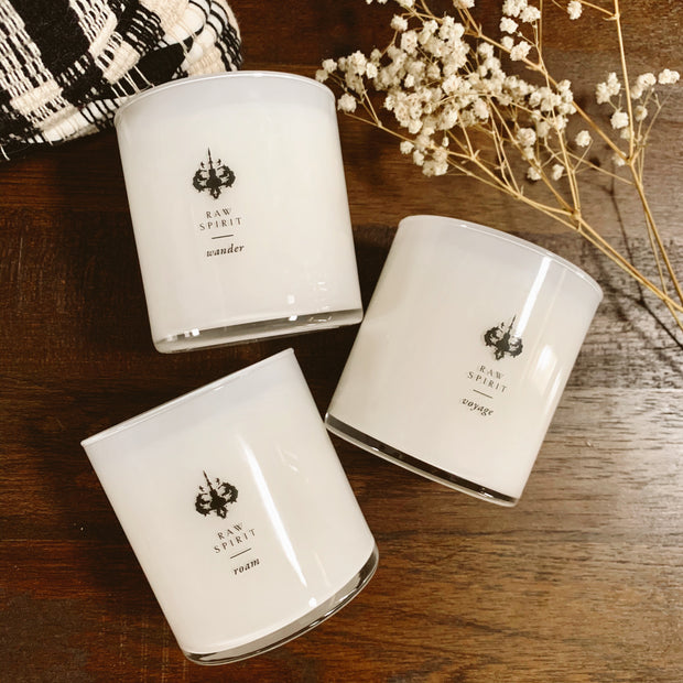 Raw Spirit exclusive Trailblazer Candle Gift Set. Featuring three, scented, hand poured candles - Wander, Roam, and Voyage - this luxury collection will transform any space into alluring oasis.