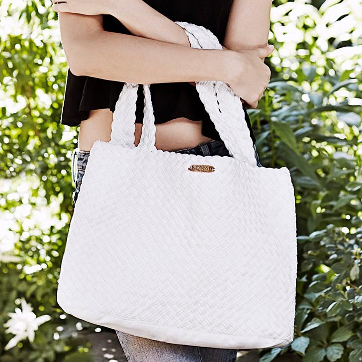 The Haitian Tote Bag is the most stunning addition to your wardrobe and Raw Spirit collection. With its convenient size and beautiful, woven design, this tote has the perfect portability and convenience. No matter the season or the destination, the Haitian Tote Bag is perfect for travel both near and far.
