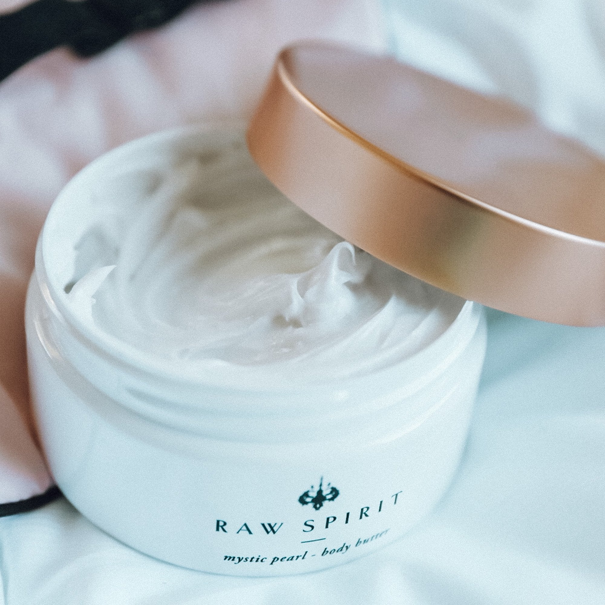 Raw Spirit Mystic Pearl Scented Body Butter is a rich floral scented moisturizer with notes of clove, cinnamon, frangipani, and jasmine.