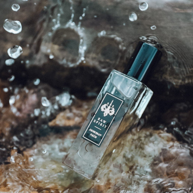 Raw Spirit Summer Rain unisex perfume is a refreshing citrus fragrance with kaffir lime and grapefruit with a burst of orangeflower and jasmine petals, anchored in a base of premium Haitian vetiver and cedarwood.