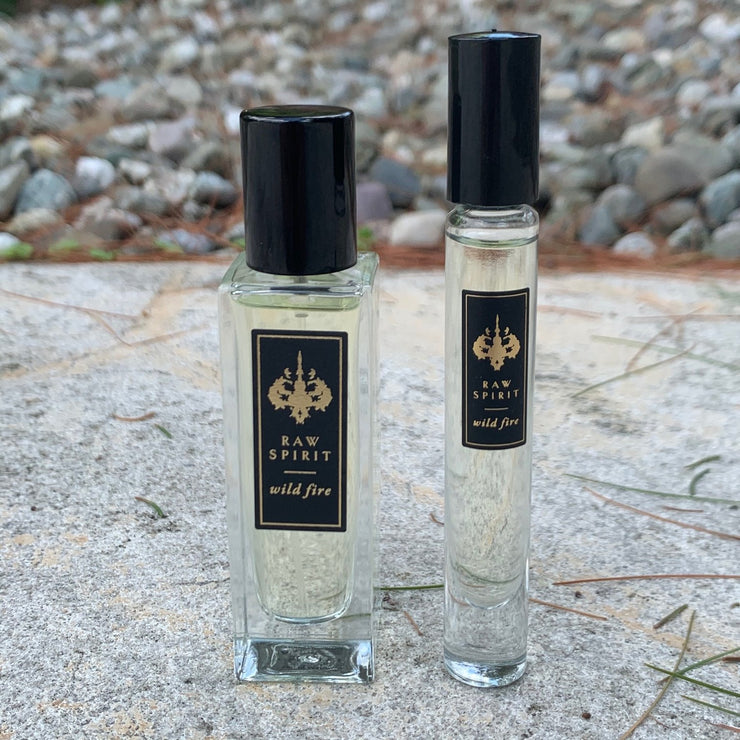 WILD FIRE Unisex Perfume Gift Set, Eau de Parfum Spray and Rollerball - a $125.00 value, yours for $95.00 (you save $30!) A seductive dry, woodsy scent which blends premium wild-harvested Australian sandalwood with creamy amber and floral notes of ylang ylang, jasmine petals, cedarwood and musk.