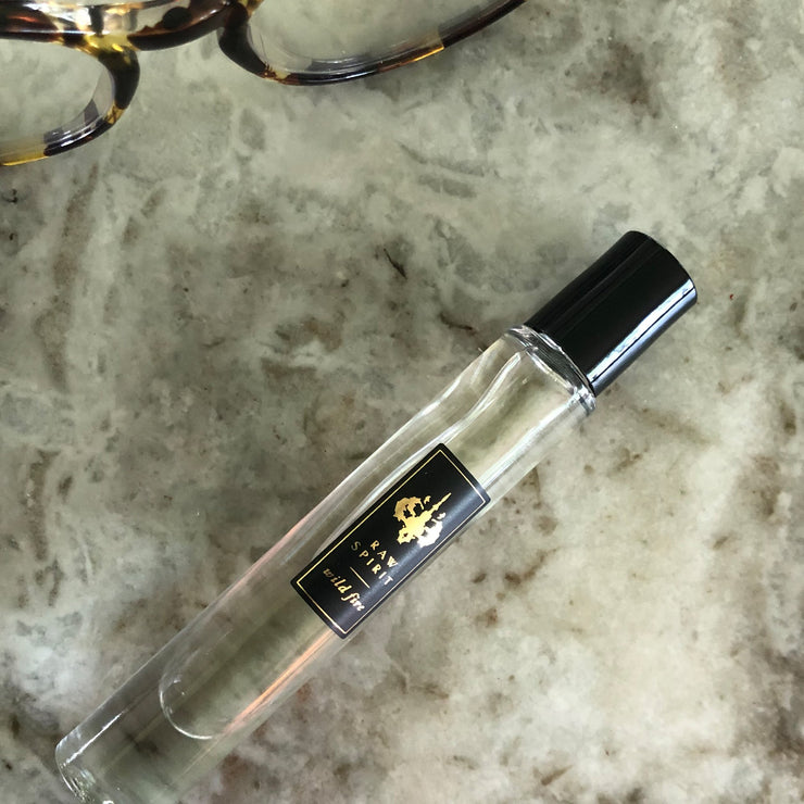 The Raw Spirit Fragrances Warm Rollerball unisex perfume duo features the woody, warm, creamy scents of Wild Fire and Winter Oak