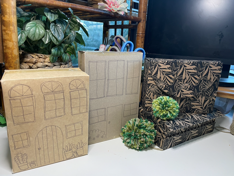 food cardboard packing repurposed as buildings for a small world playvillage