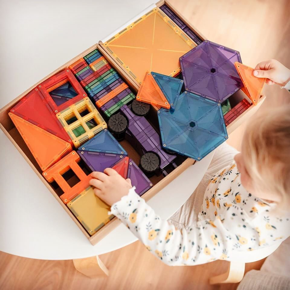 mega pack of connetix tiles in the box with a child