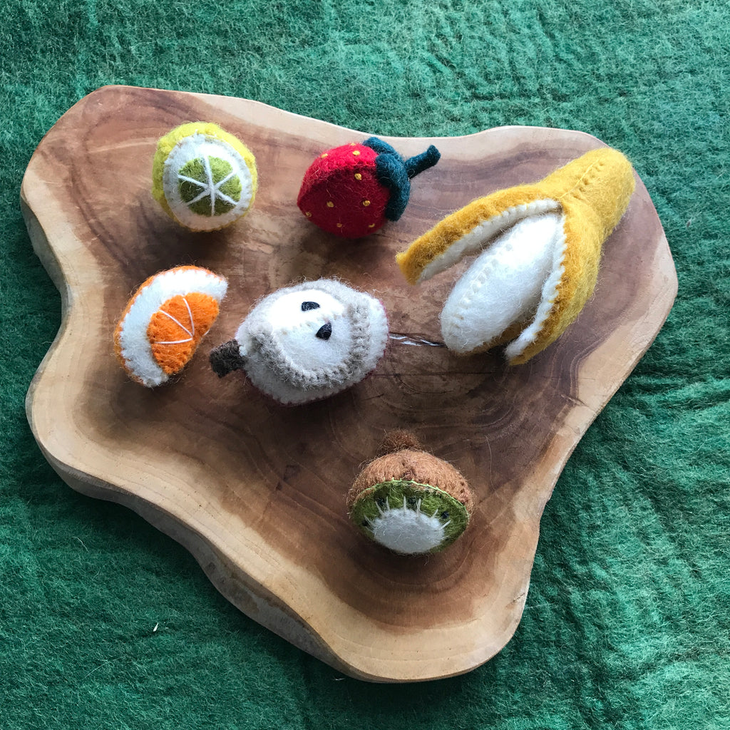papoose toys felt fruit box set on a wooden slice