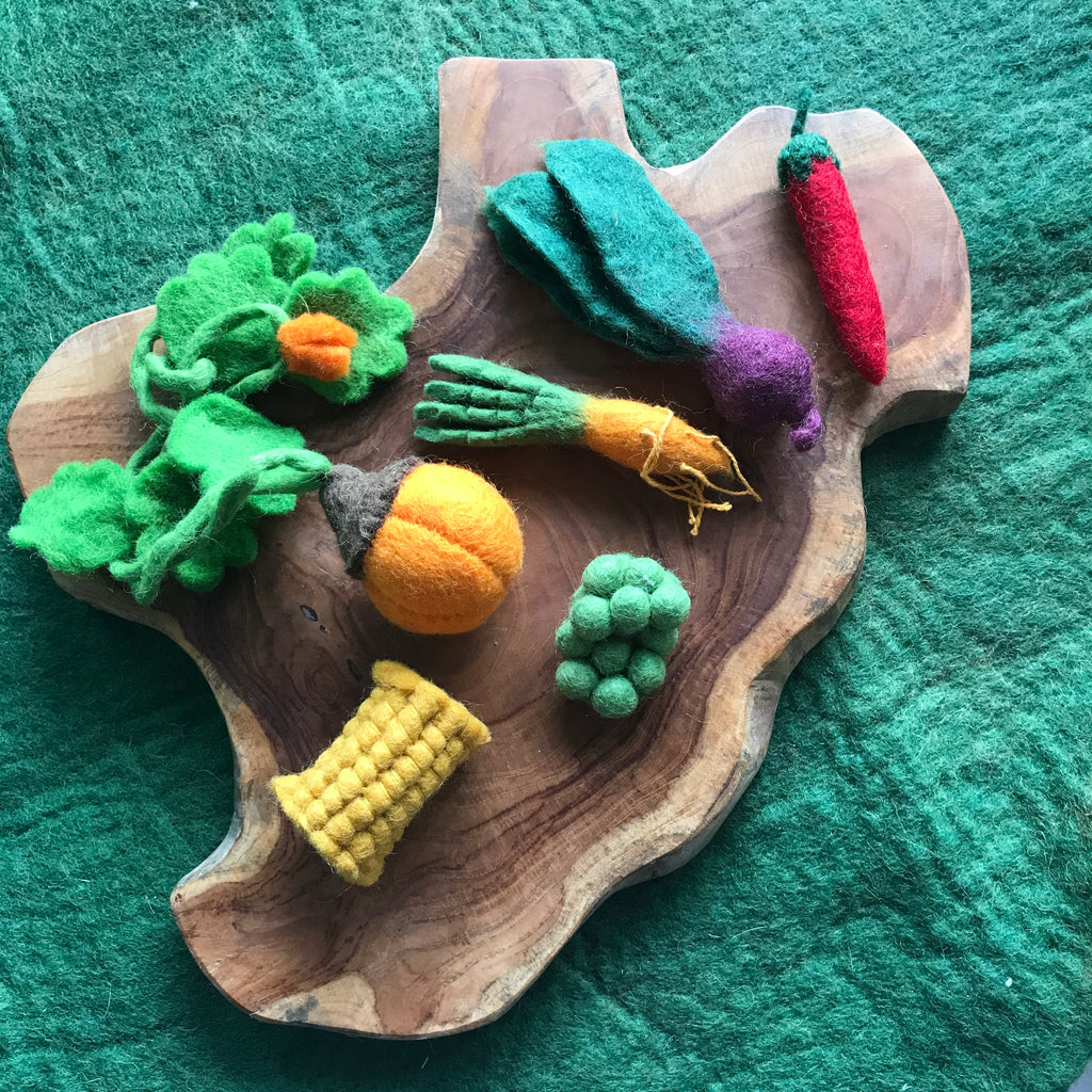 papoose toys felt veggie box on a wooden tray