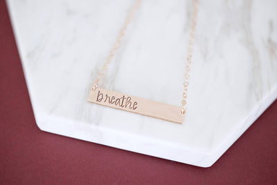 Breathe Bar Necklace , flat lay