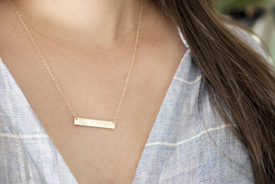 Roman Numeral Bar Necklace, close up on neck