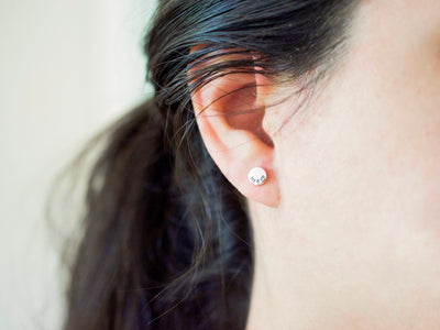Initial Stud Earrings, in ear view