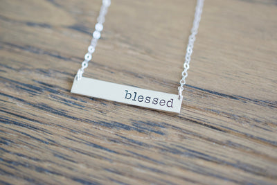 Blessed Necklace, wood background
