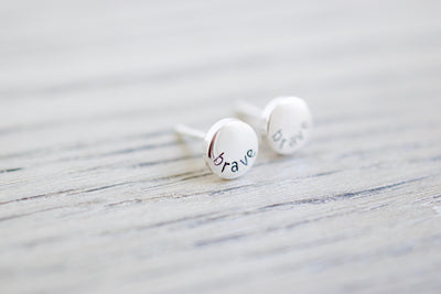 Brave Stud Earrings, wood background