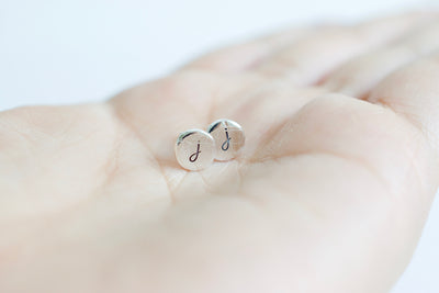 Initial Stud Earrings, in hand