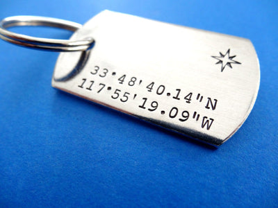 Coordinates Dog Tag Keychain | Custom Stamped Keychains, on blue background