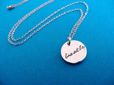 Breathe Hand Stamped Necklace, flat lay
