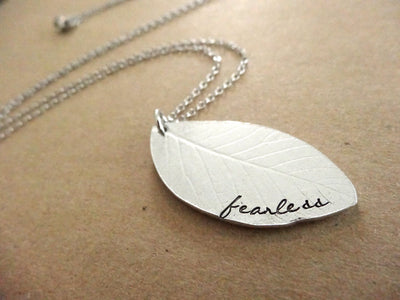 Fearless Necklace, tan background