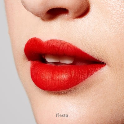 "Clove + Hallow Lip Velvet - Clean, vegan and cruelty-free long wear matte liquid lipsticks in vibrant, flattering, wearable shades. ""Fiesta"" is a bright true red."