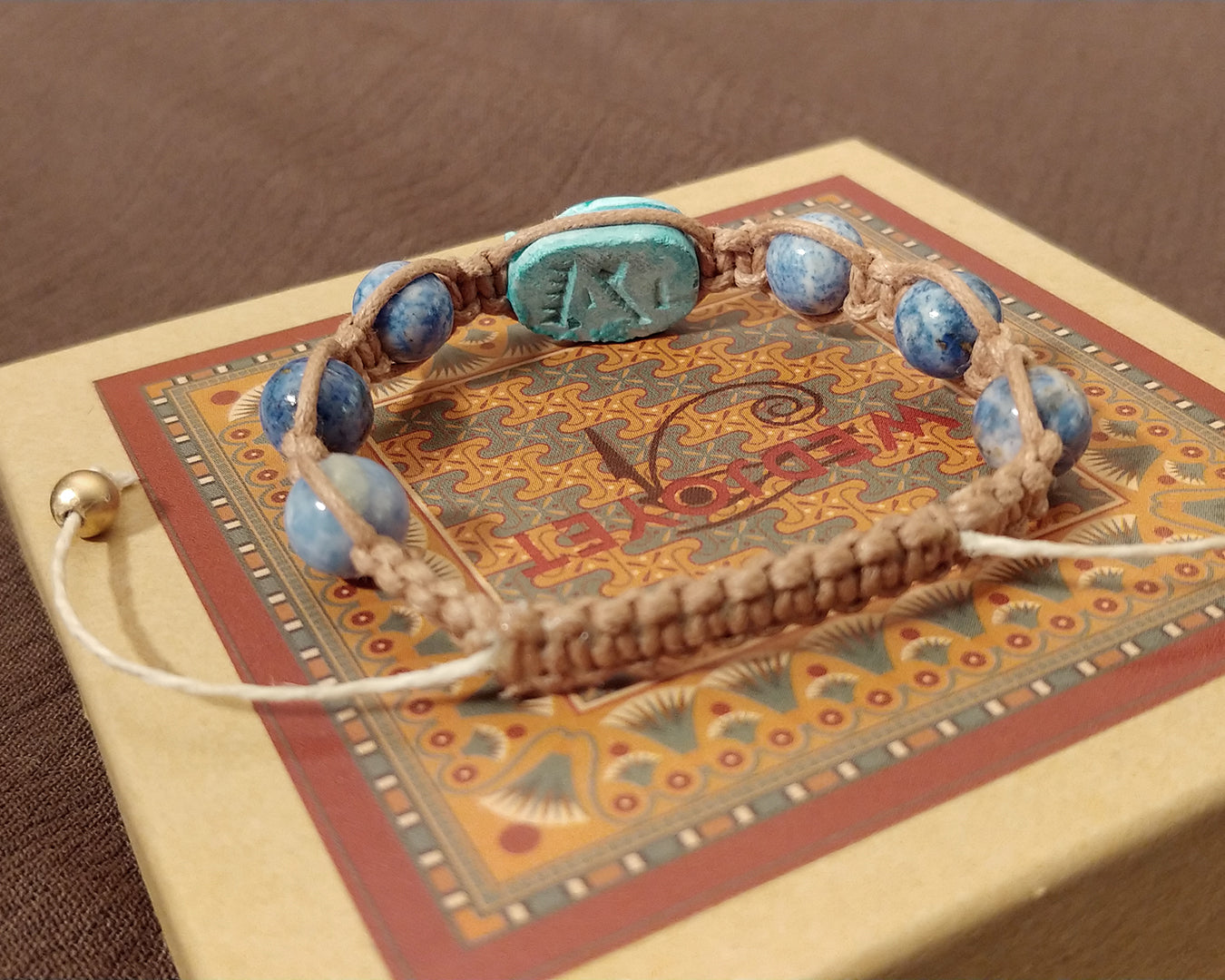 Men and Women's Ancient Egyptian Adjustable Marbled Lapis Lazuli Macrame Bracelet with Blue Porcelain Scarab with Hieroglyphs.