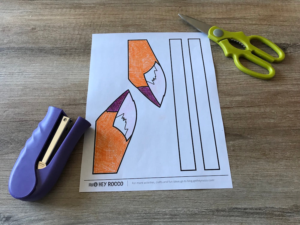 The Rocco ears activity sheet printed with scissors and a stapler