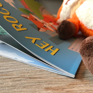 A close of picture of the Rocco plush toy and Hey Rocco storybook