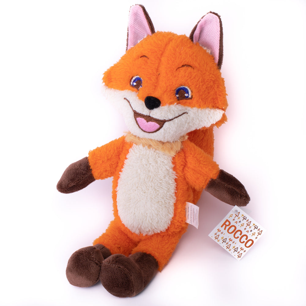 A picture of the Rocco plush fox sitting on a white backdrop