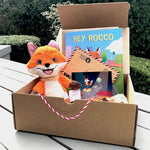 A opened Hey Rocco box set containing a Rocco plushie, the Hey Rocco storybook and a letter.