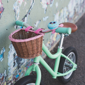Bike with premium kids bike scooter wicker basket attached with hand painted pink trim and belt with buckle attachment
