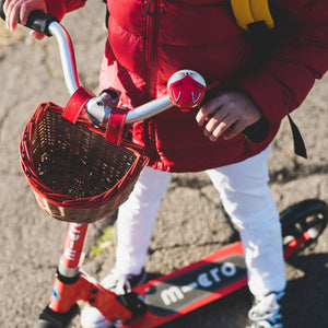 child on scooter with premium wicker basket with hand painted red trim and belt with buckle attachment