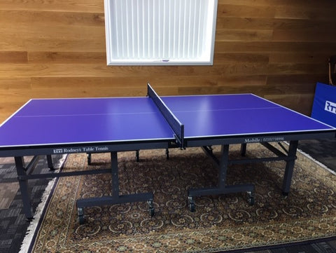 25mm Table Tennis table fold up with big wheels 2 great bats, $65 Net and 6x 3star balls