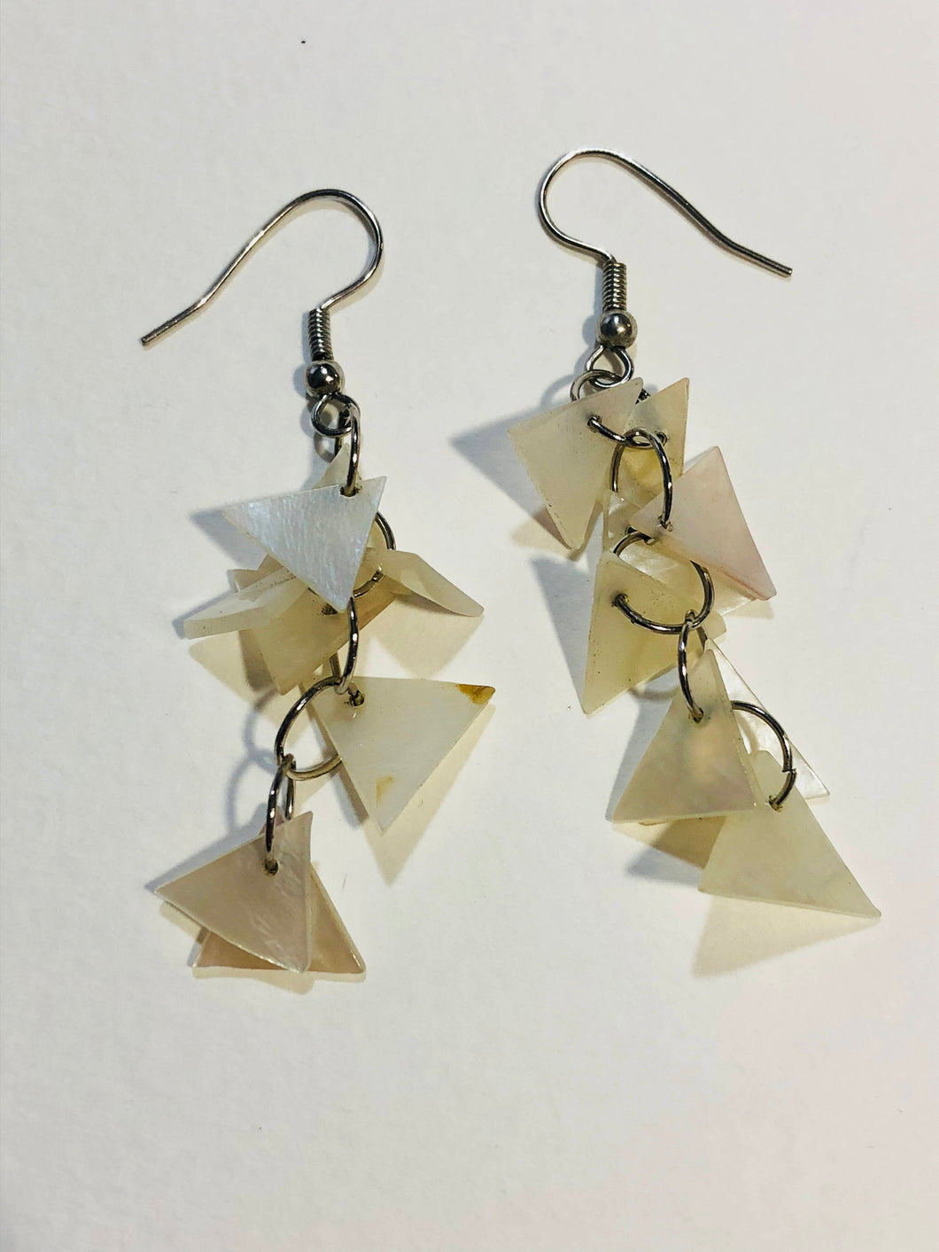 Dangling white shell triangles silver color earrings