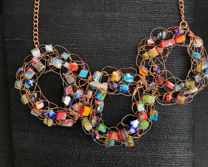 Three copper wire crochet rings with multicolor glass beads and copper chain necklace
