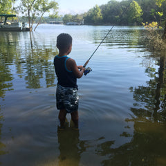 Boy Fishing in River