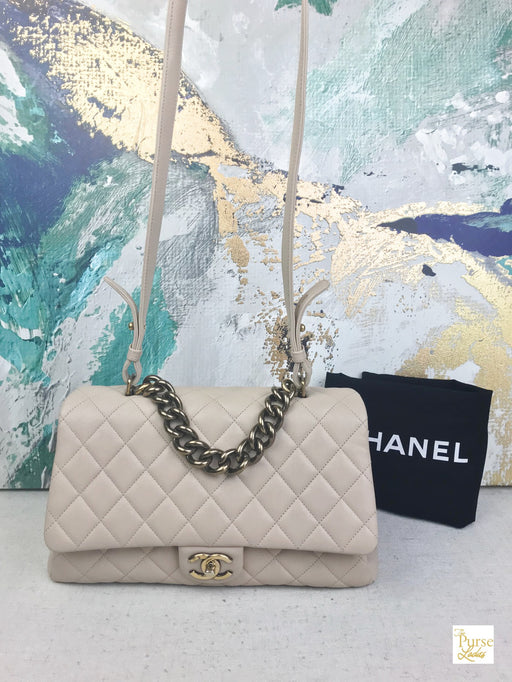CHANEL Beige Quilted Leather Large Trapezzio Flap Bag