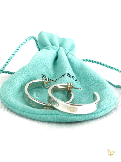 TIFFANY & CO. Sterling Silver Narrow Concave Hoop Earrings
