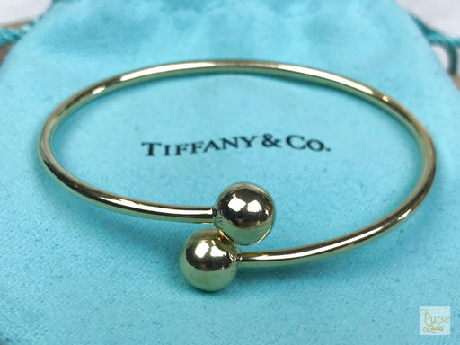 TIFFANY & CO 750 18k Gold Ball Bypass Bracelet