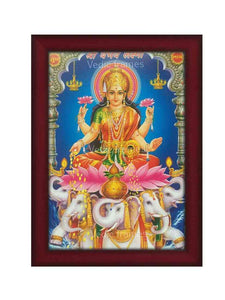 Vaibhav Lakshmi in red vasthram on lotus with elephants at the base