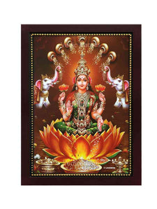 Goddess Lakshmi on yellow lotus in a plain brown background with gold shower
