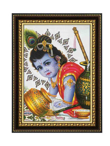 Little Krishna crawling, with overturned butter pot