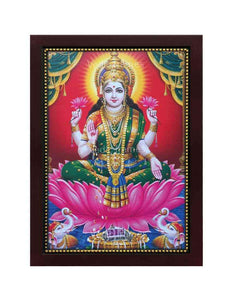 Goddess Lakshmi with yellow halo in red background