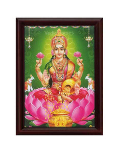 Mahalakshmi in green background with hanging lamps