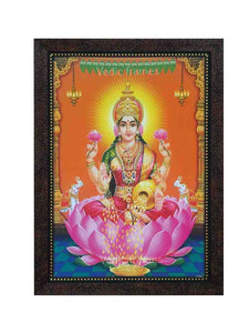 Goddess Lakshmi with halo in orange background