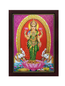 Mahalakshmi standing on lotus under gold coin arch