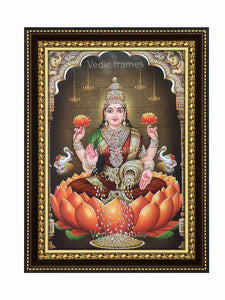 Goddess Lakshmi under arch in a sanctum with hanging lamps